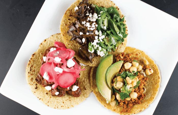 Vegetarian Taco Trio. Chipotle mushroom, faux mole, and chorizo tacos -