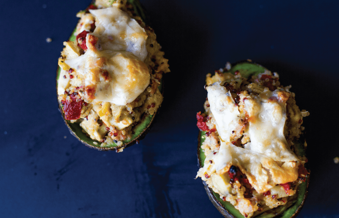 Italian Sausage Stuffed Avocados - these tasty avocados are packed with Italian chicken sausage, quinoa, roasted red bell peppers and parmesan cheese.