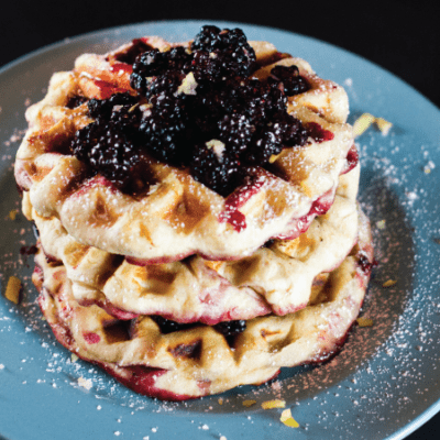 Blackberry Stuffed Waffles on blue plate