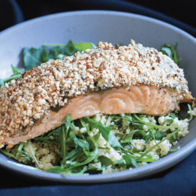 Cashew Crusted Salmon with Pesto and Honey over arugula