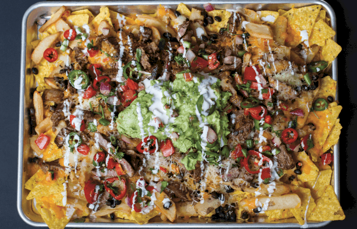 overhead shot of Loaded Monster Carne Asada Nachos