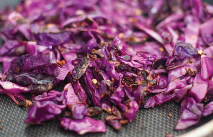 chopped red cabbage sautéing in pan