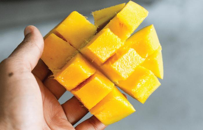 Meiko holding cubed mango