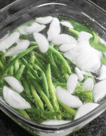 green beans in a chilled ice water bath