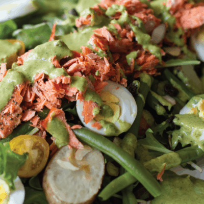 Mediterranean Salad with boiled eggs, green beans, and smoked salmon