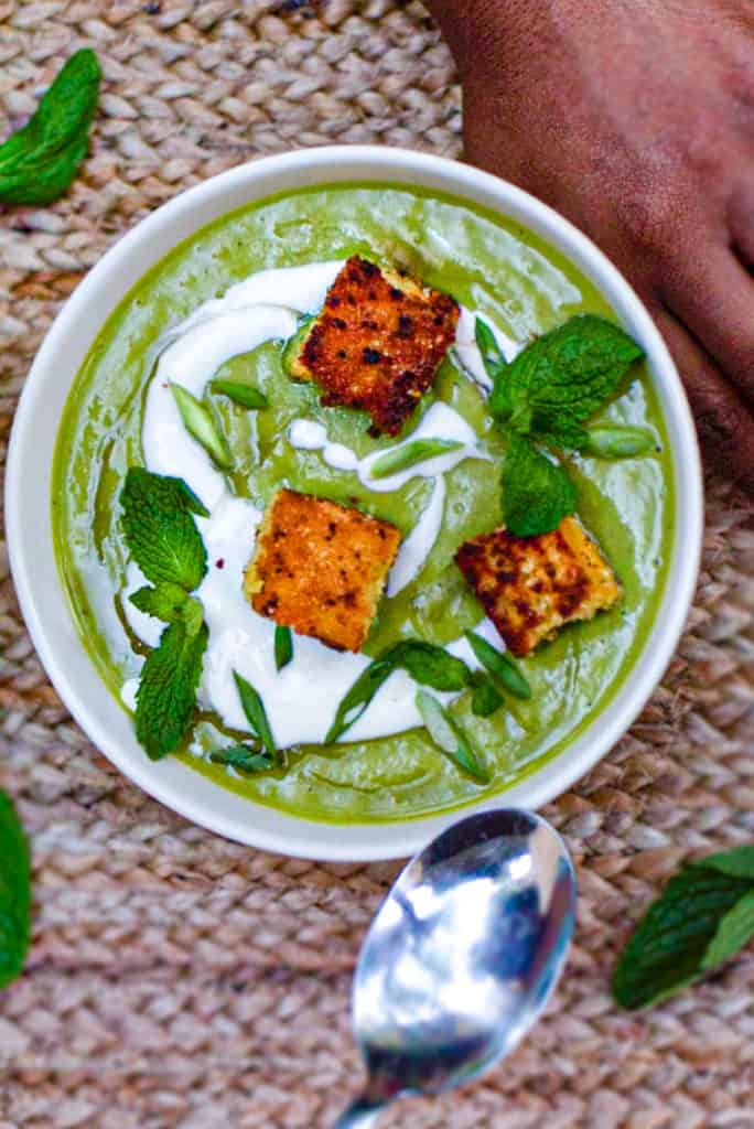 bowl of pea & mint soup with cornbread croutons