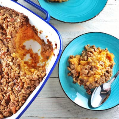 Scoop of Candied Yam Casserole with Brown Sugar Streusel