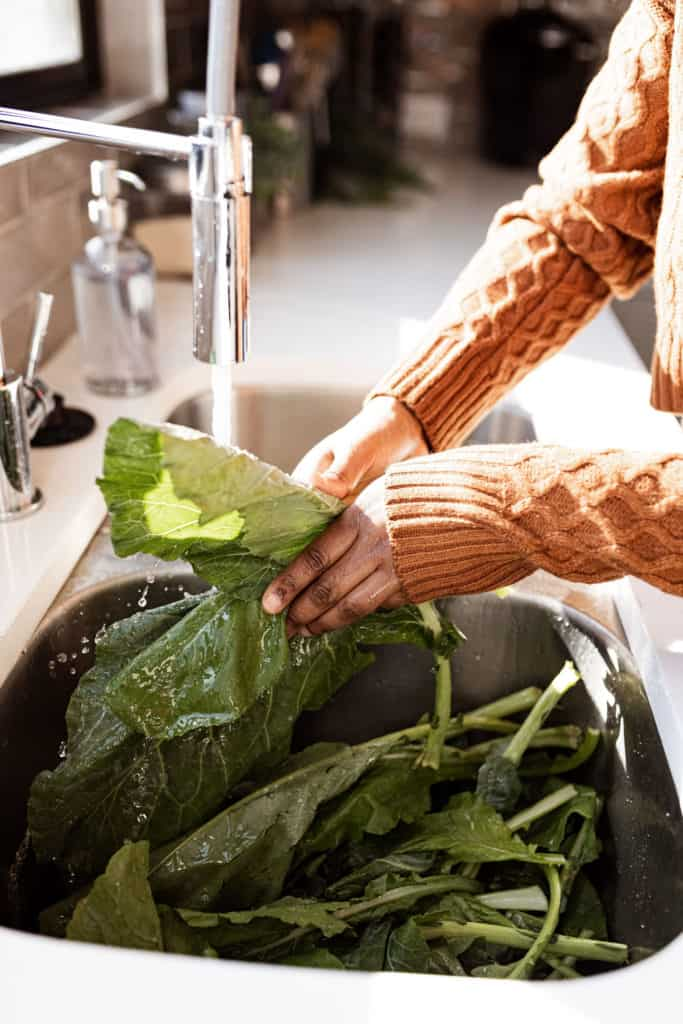 Cleaning greens in kitchen sink