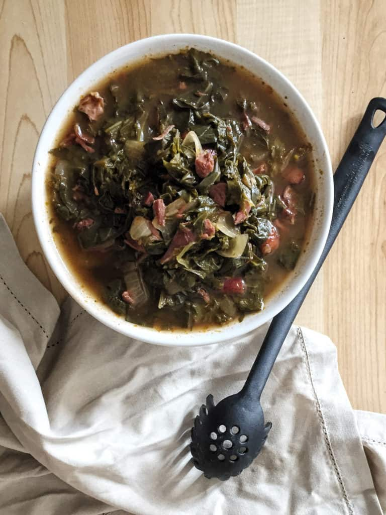 bowl of southern style greens with a spoon