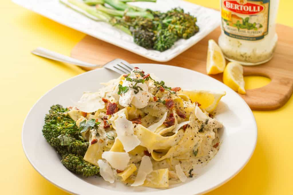 Bertolli creamy basil alfredo pappardelle with bacon pieces and Shaved Parmesan on top baby broccoli