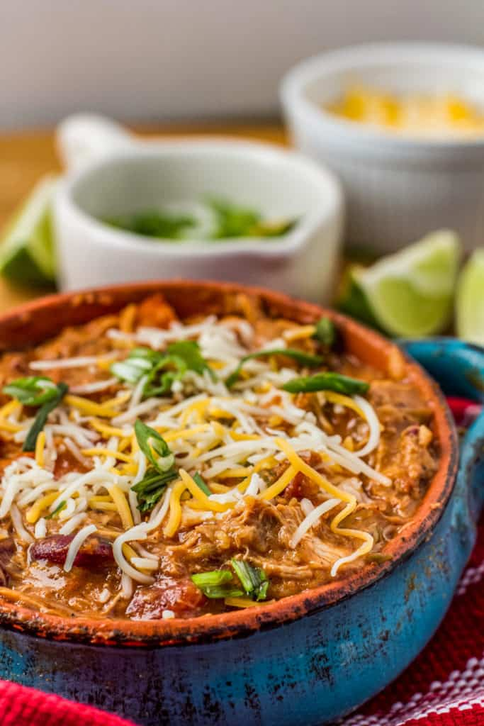 bowl of pulled chicken chili topped with cheese