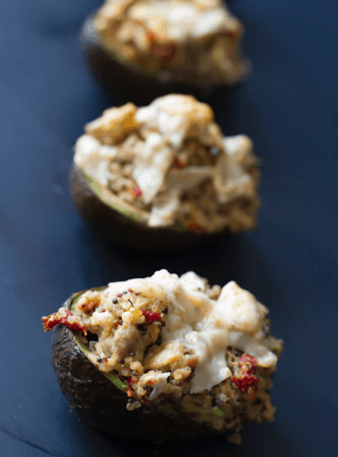 Italian Sausage & Quinoa Stuffed Avocados - these tasty avocados are packed with Italian chicken sausage, quinoa, roasted red bell peppers and parmesan cheese.