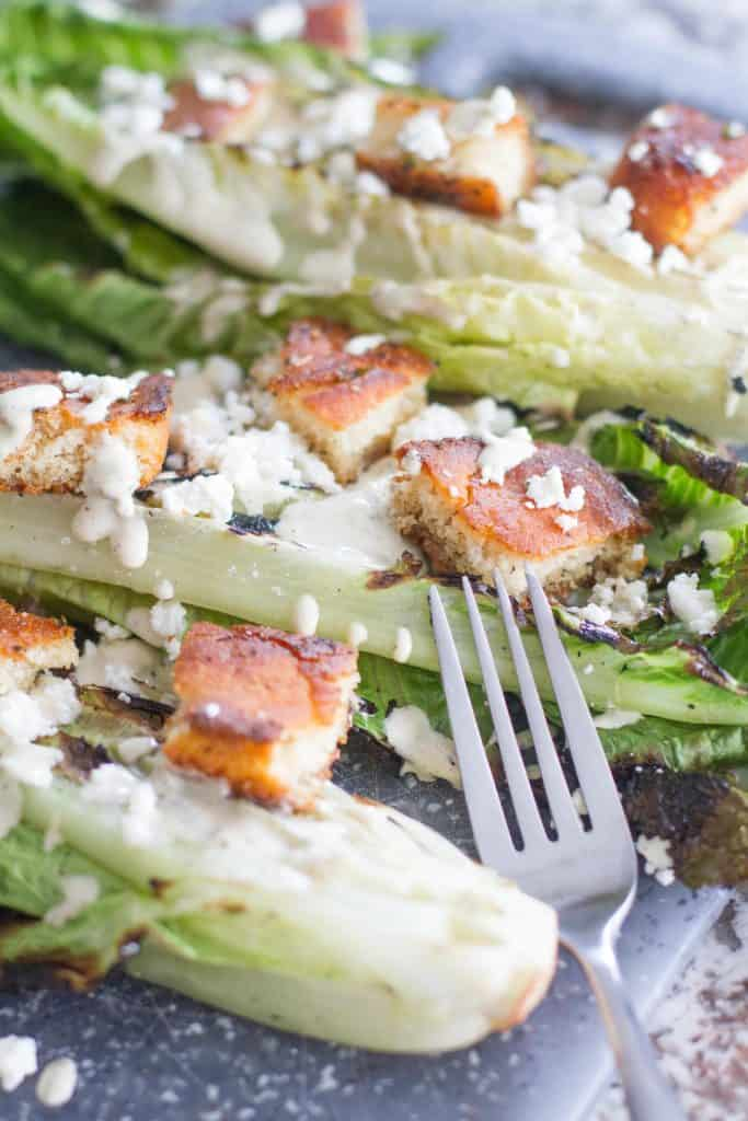 platted Grilled Romaine with Smoky Caesar Dressing and croutons
