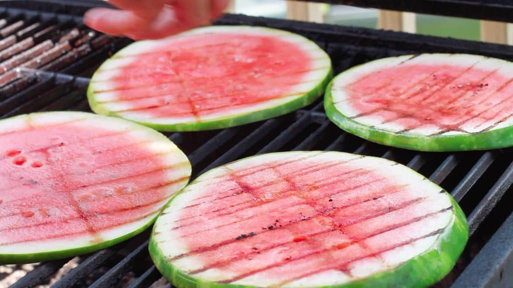 Honey glazed and grilled watermelon topped with goat cheese, mint and shallots