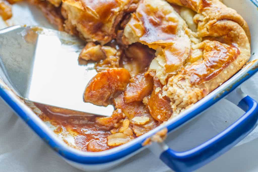 Close up of candied Bourbon Peach Cobbler in baking dish
