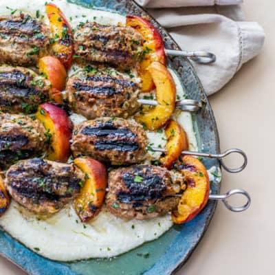 turkey kefta & peach kabobs on top of whipped feta