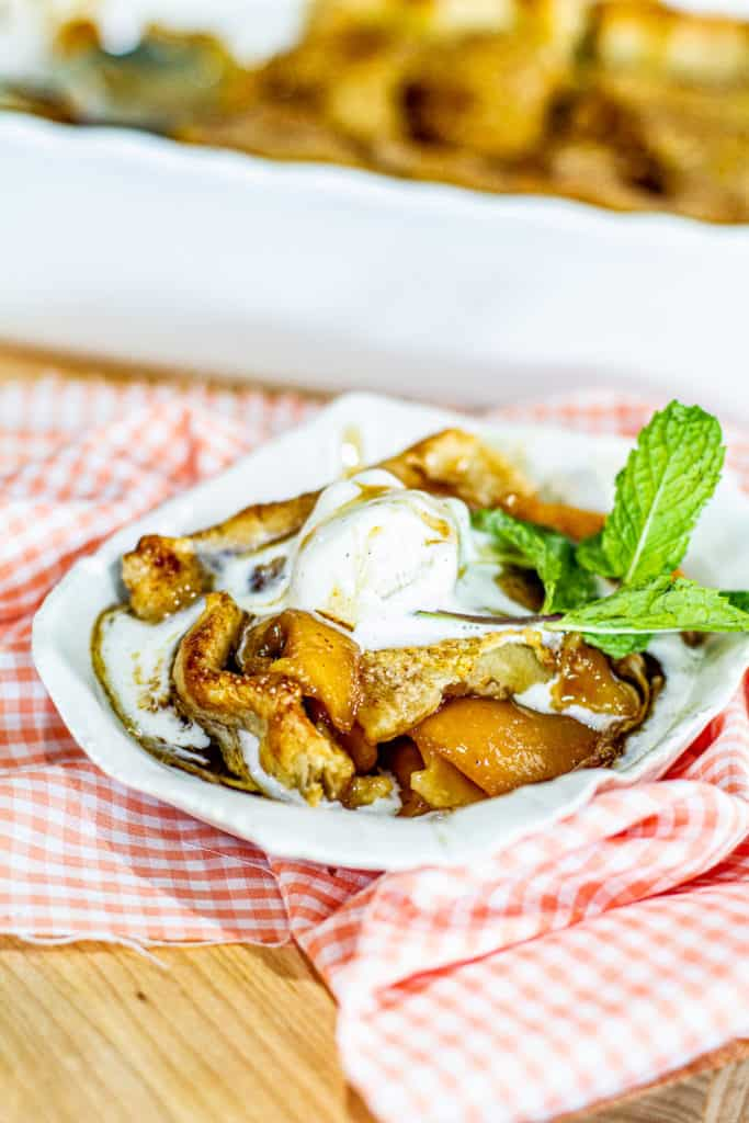 Peach Cobbler with ice cream on plate