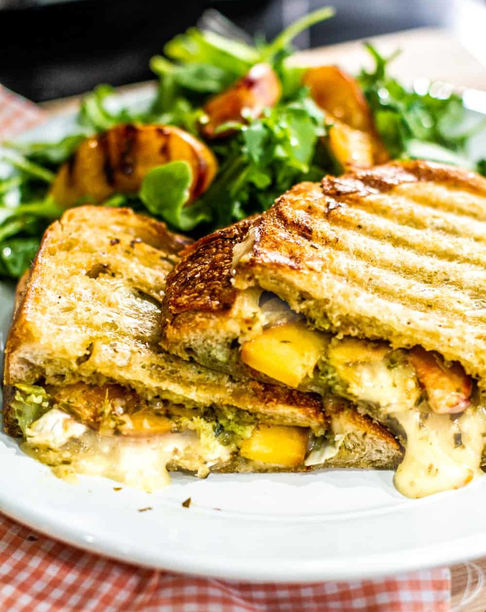 close up Grilled Peach Panini with a grilled peach salad plated