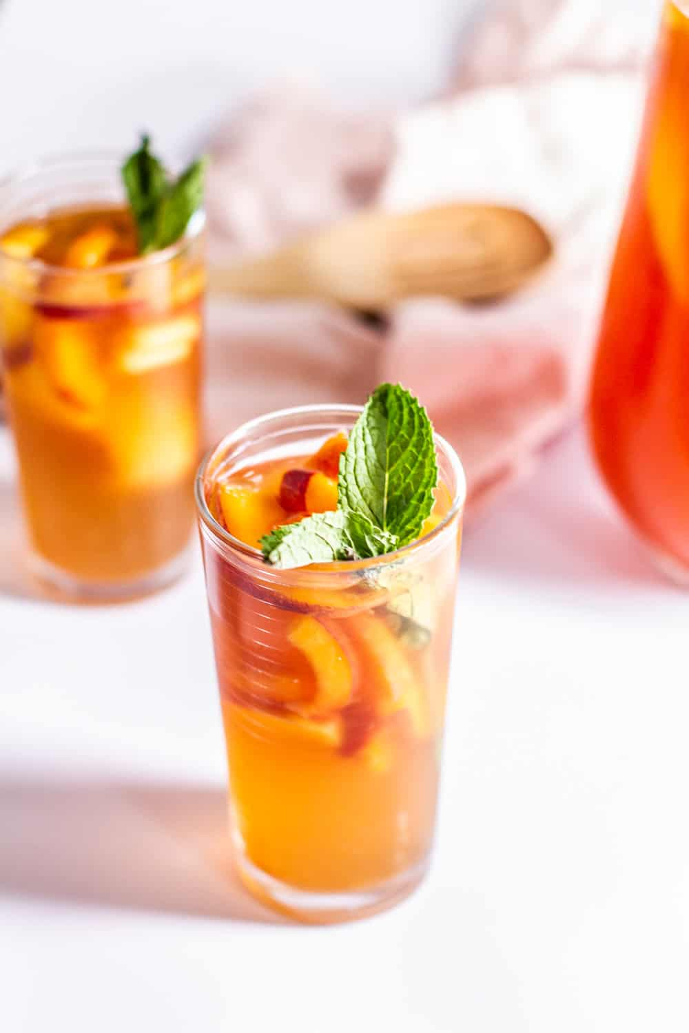 Glass of Peach Sweet Tea with mint
