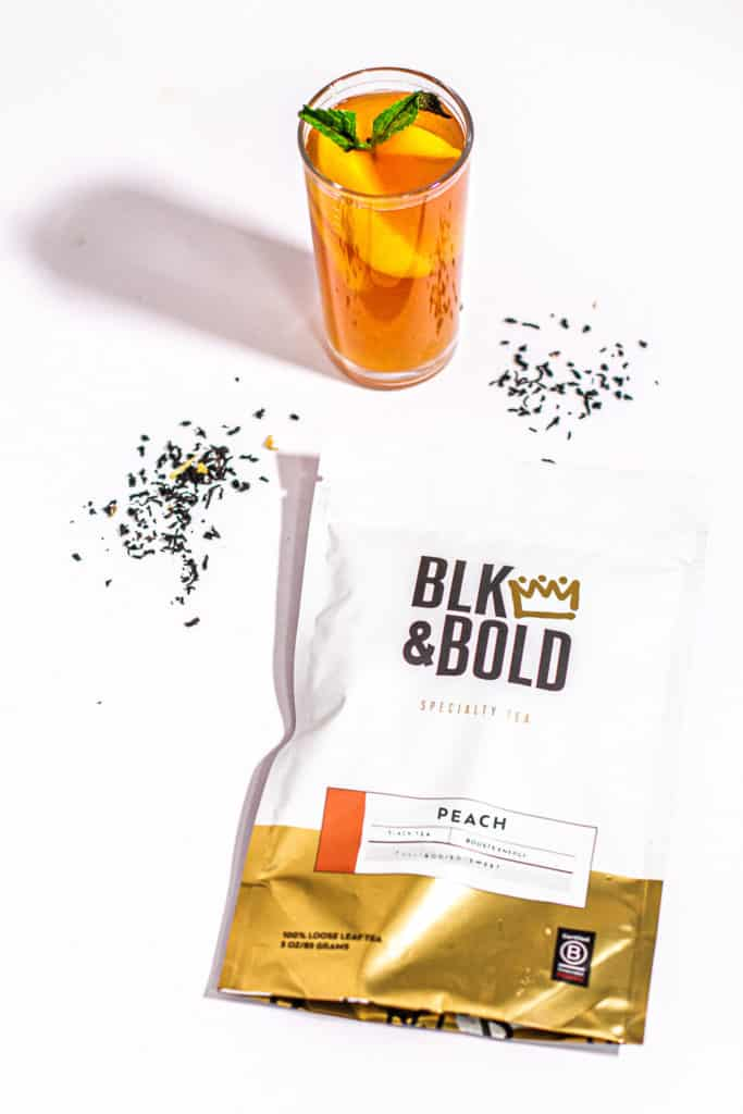 glass of Peach Sweet Tea with blk and bold tea