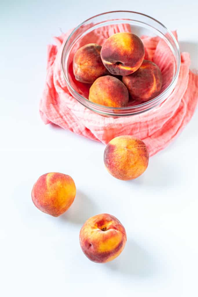 fresh peaches in a bowl