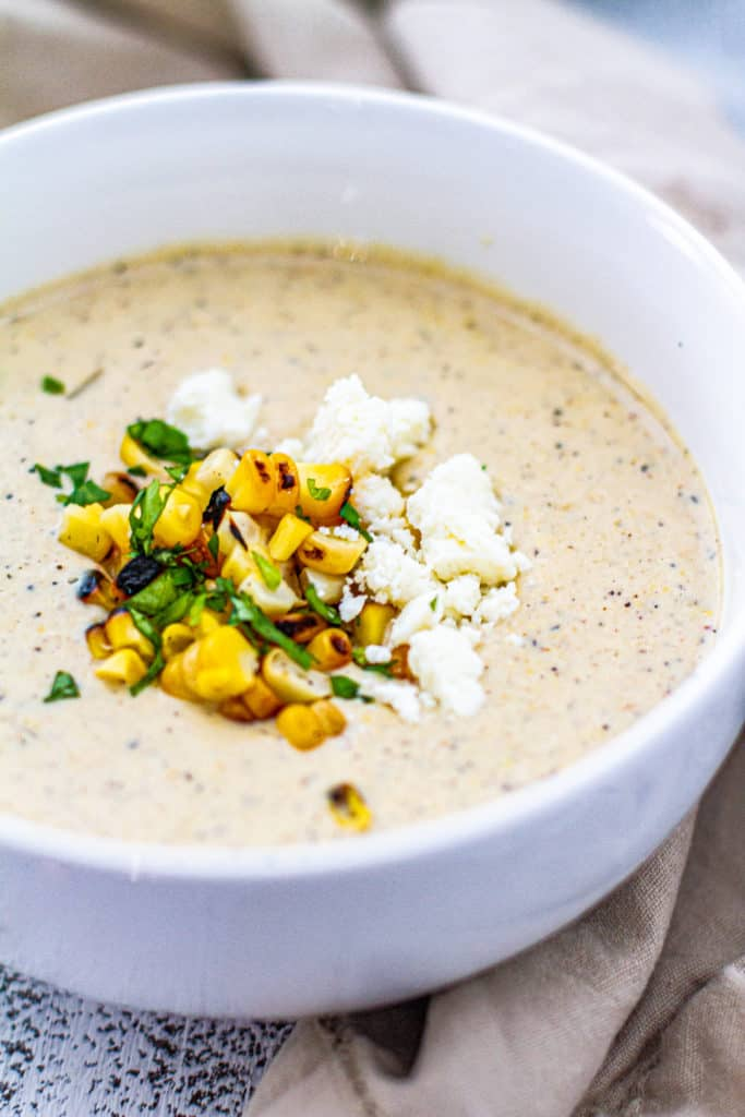 elote corn chowder in a white bowl