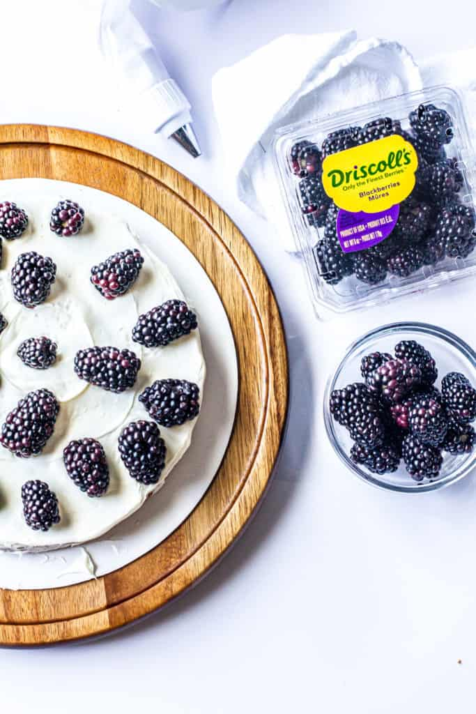 blackberry naked cake topped with fresh blackberries