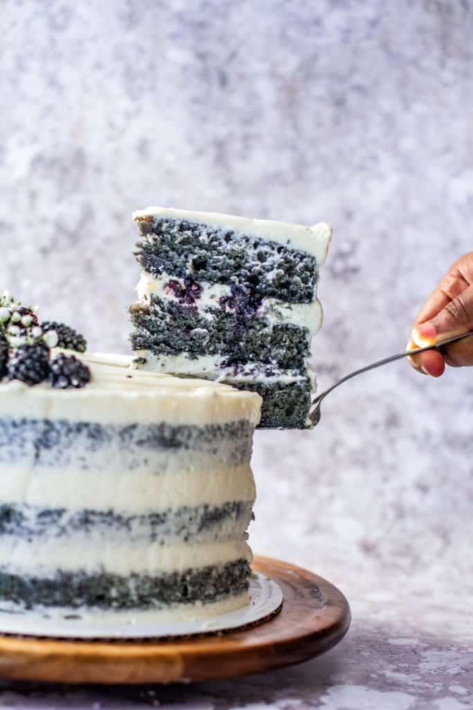 Slice of blackberry naked cake