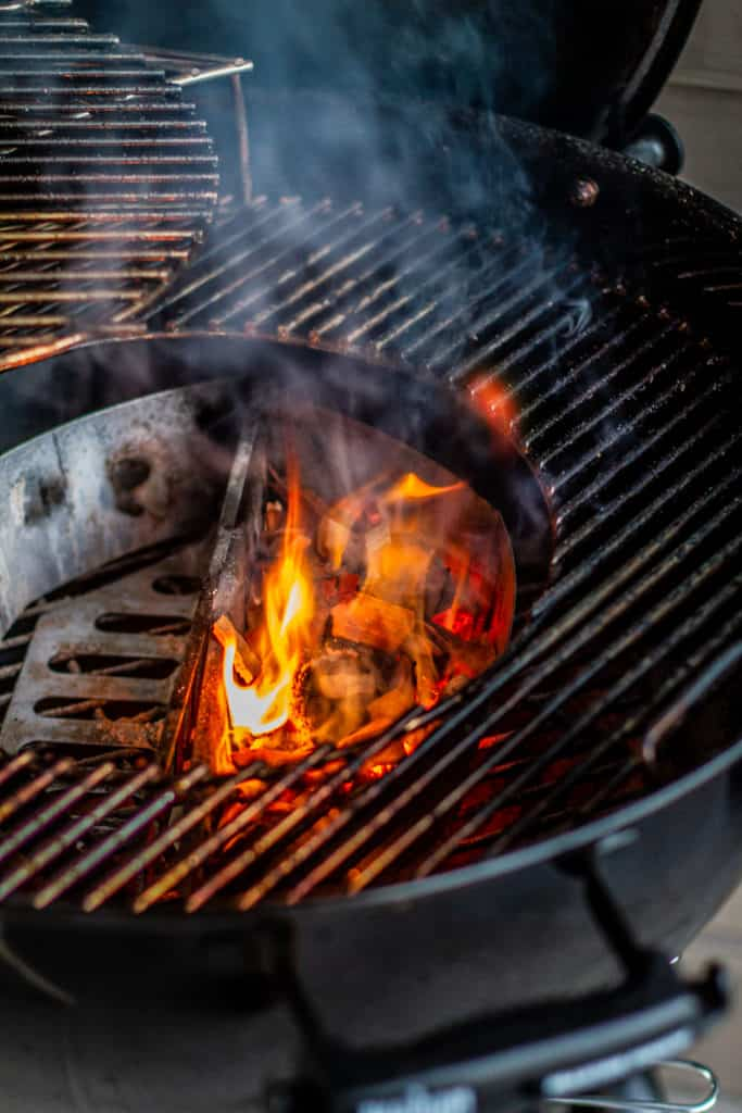 charcoals with fire in weber grill
