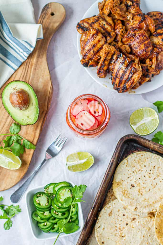 toppings for tacos, pickled radishes, avocados, jalapenos, margarita chicken and tortillas