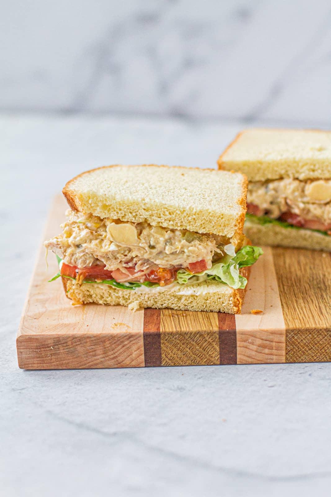 chicken salad sandwich cut in half