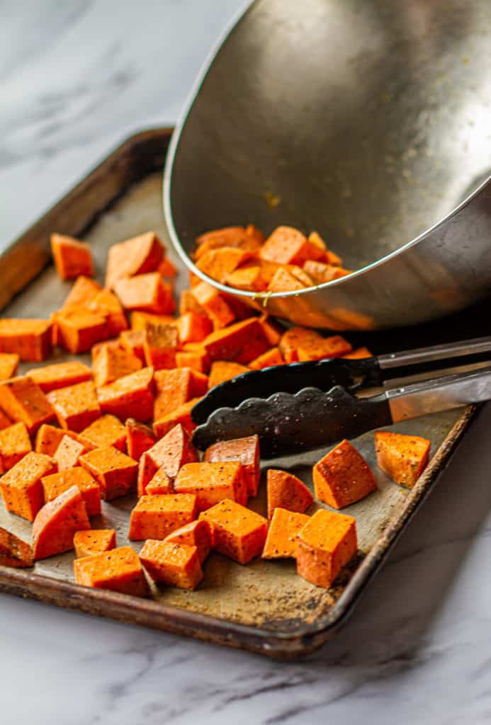 cubed sweet potatoes on sheet pan for detox glow bowl
