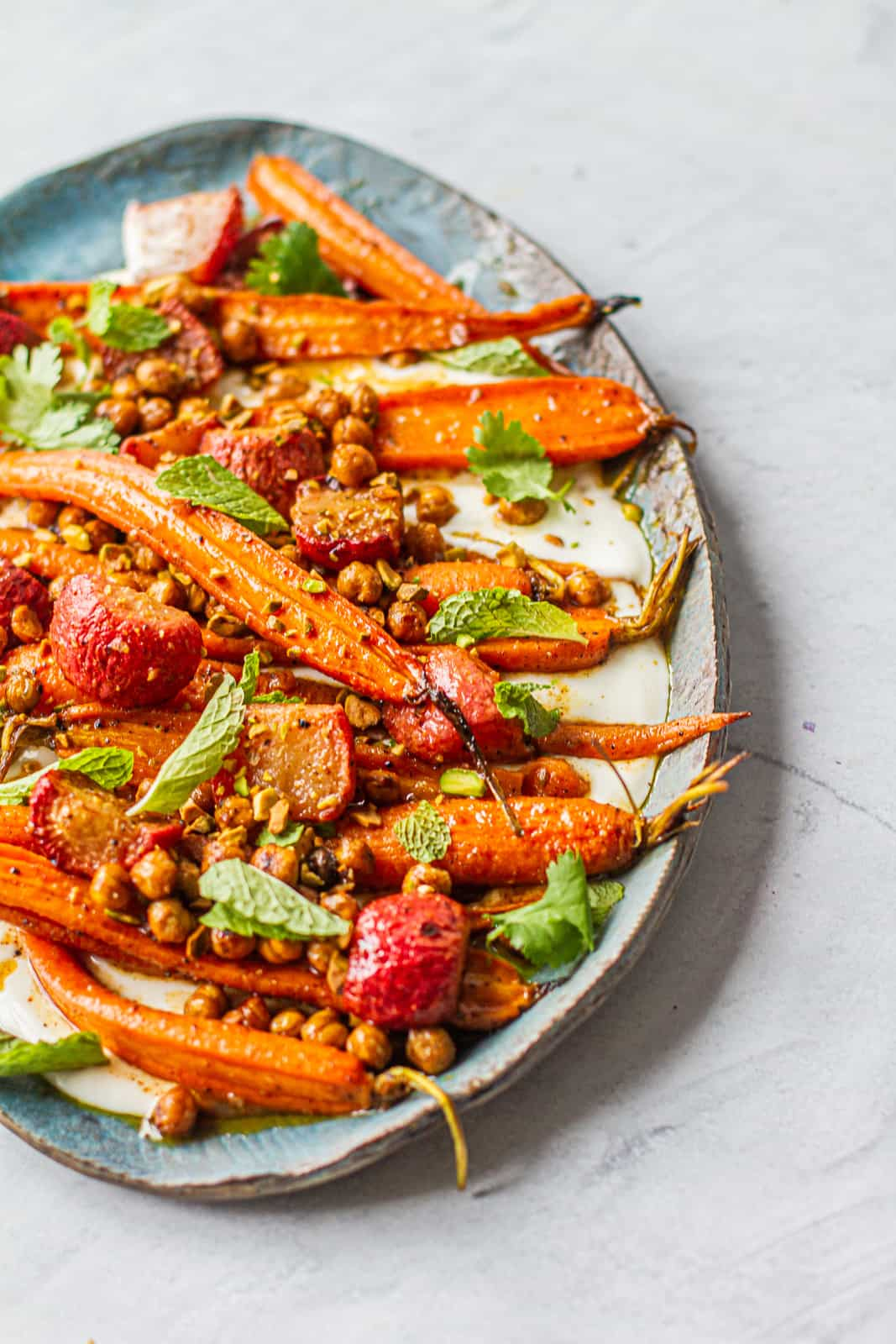 Close up of platter with moroccan-spiced carrot & radish salad over a napkin