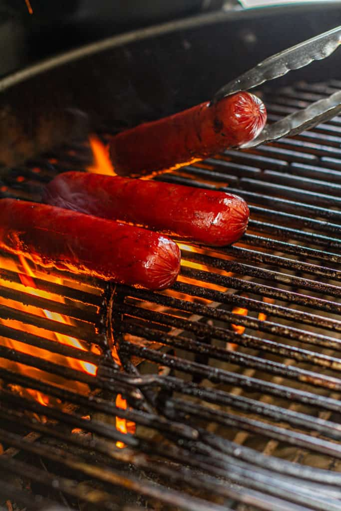 fat from hot links dripping on the grills fire