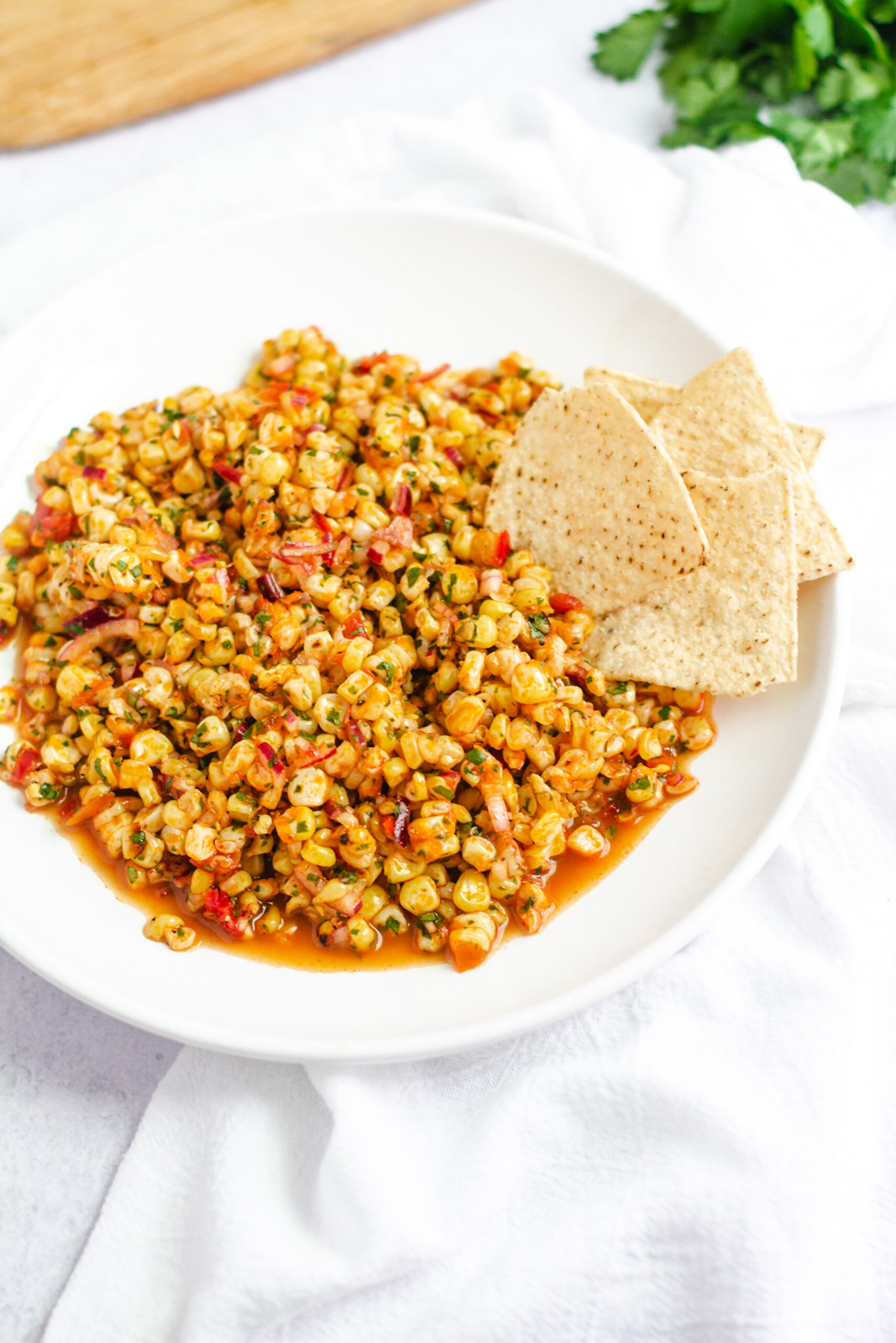 red spicy corn salsa in a bowl