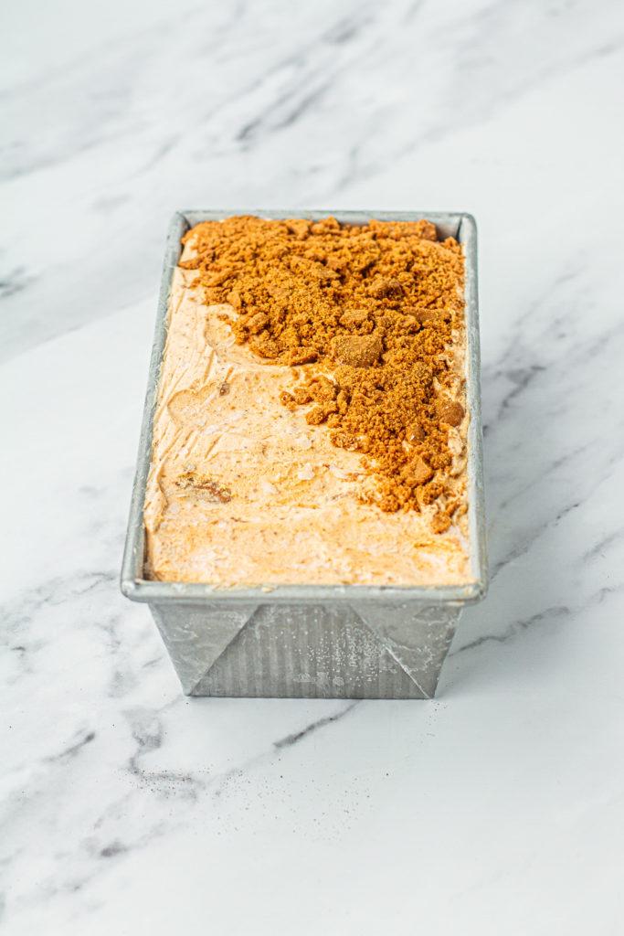 pumpkin ice cream with layer of crumbled biscoff cookies