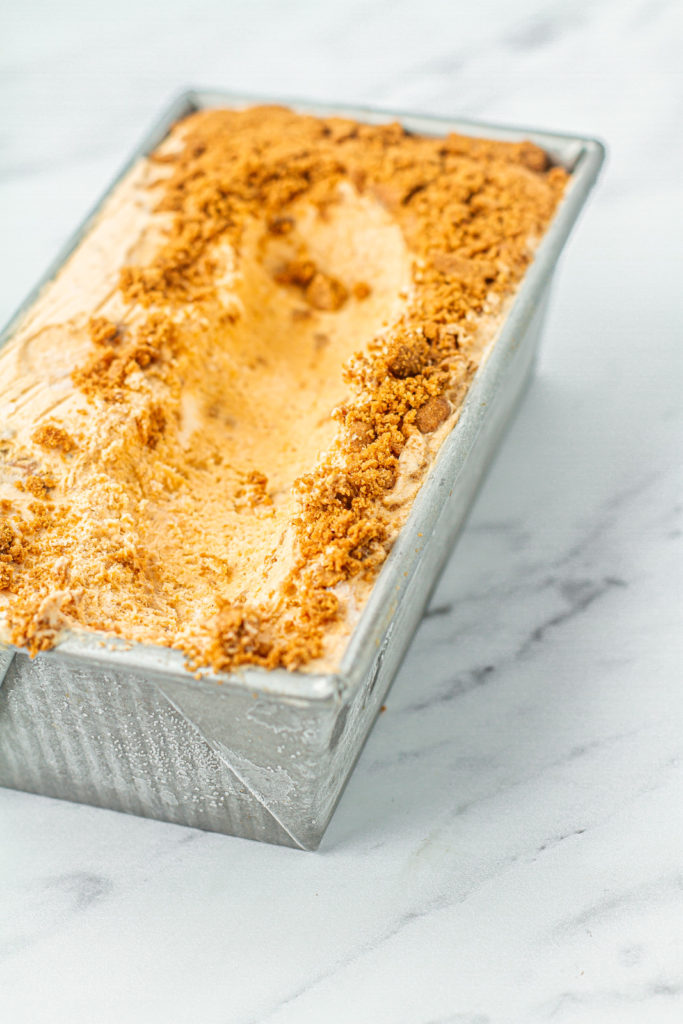 pan of pumpkin spice ice cream with missing scoop