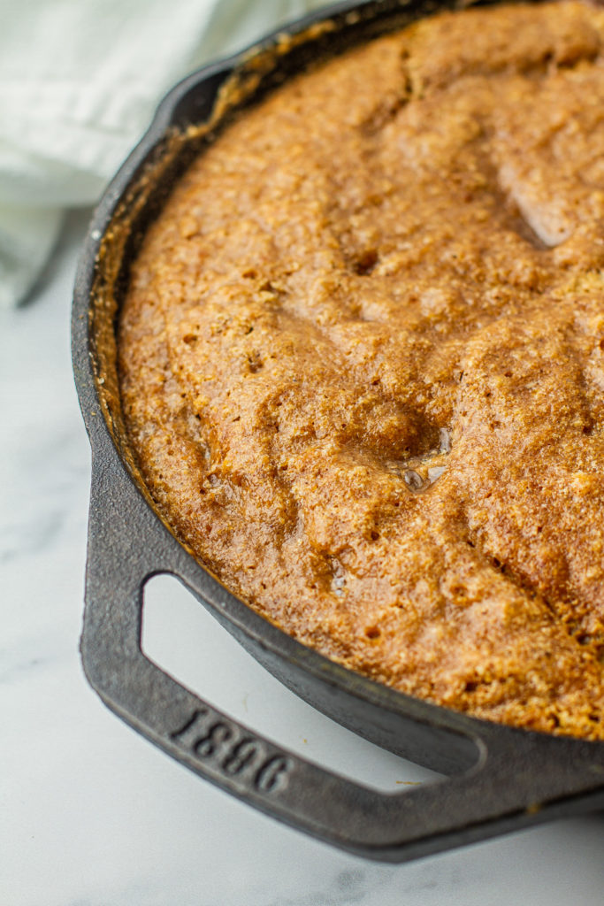 close up of cast iron skillet with pumpkin pudding